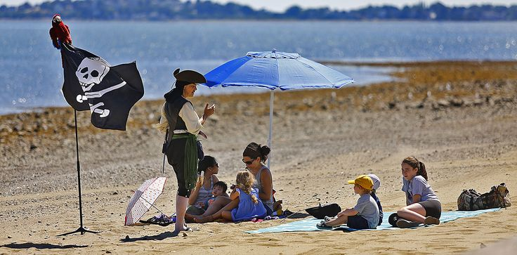 """Mary Read the Pirate Story Teller""""entertains kids on Wollaston Beach as part of the cities """"50 Days of Freedom"""" which provides fun stuff for families at no cost  on Wednesday, July 27, 2016. Greg Derr/ The Patriot Ledger."""