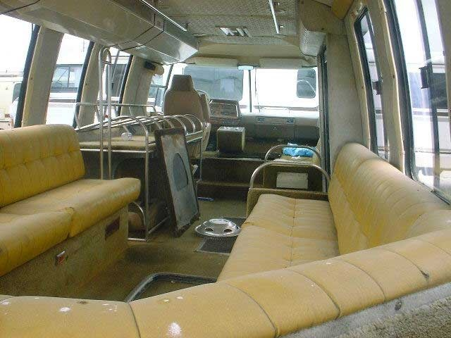 This guys blog has a lot of good stuff. Another GMC Motorhome used as an airport shuttle or something similar. (interior)