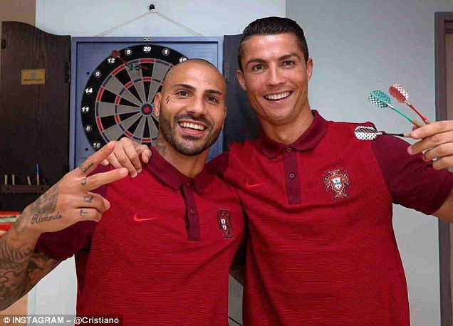 Ronaldo poses alongside Ricardo Quaresma during a relaxed round of darts before flying out to Lyon