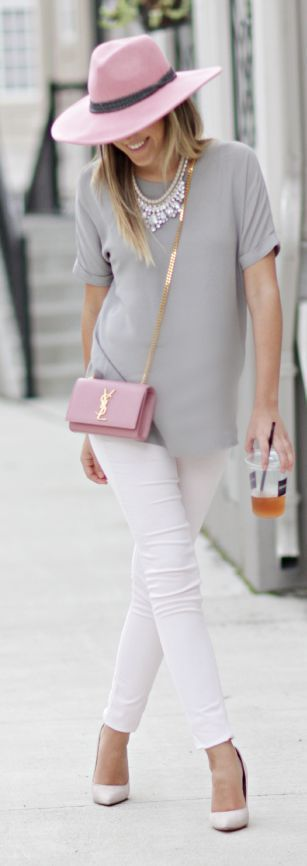 Have your pink YSL crossbody bag be the star of this outfit by pairing it with a gray tee, statement necklace and white denim jeans!