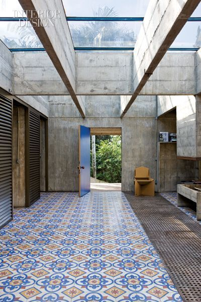 cement tile floor in a high industrial ceiling design. | Architecture