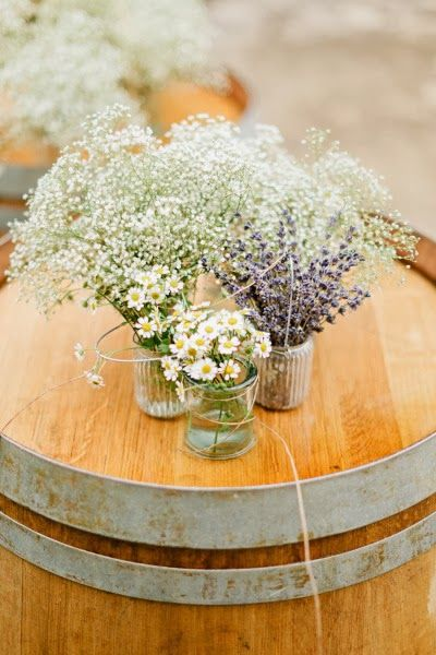 Simple arrangements of baby's breath, lavender and feverfew are perfect for a rustic or outdoor celebration