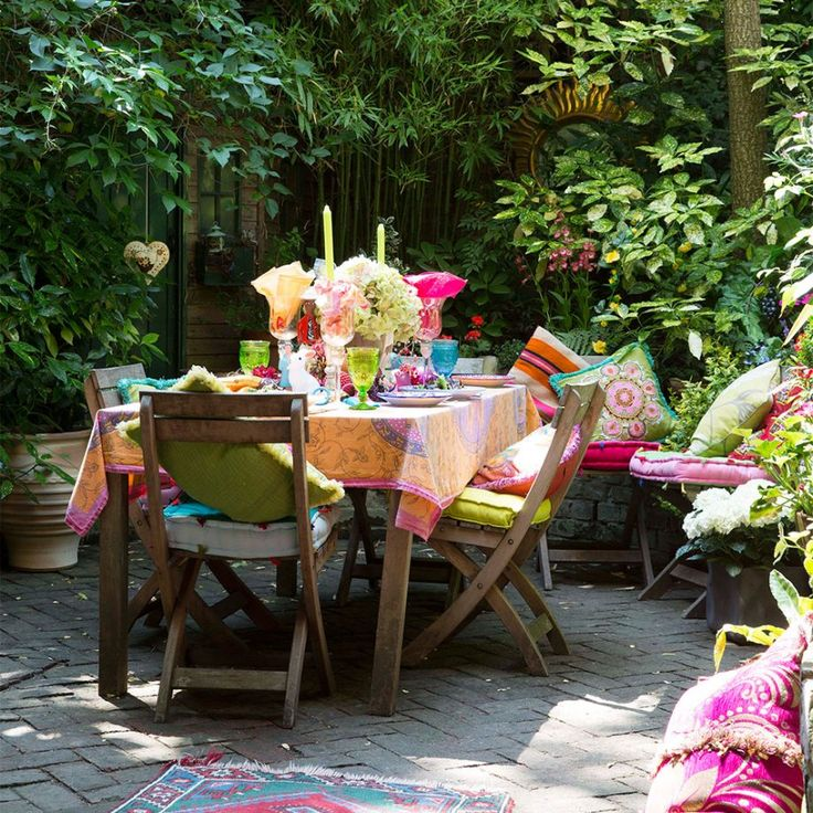 Garden patio living area with colourful accessories Bring a more exotic feel to your space with richly patterned and colourful accessories that are more reminiscent of a Moroccan riad.