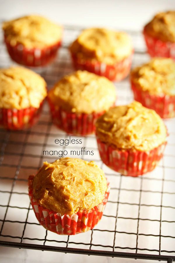 eggless mango muffins recipe with step by step photos. delicious mango muffins made with fresh mangoes, whole wheat flour, condensed milk and butter.
