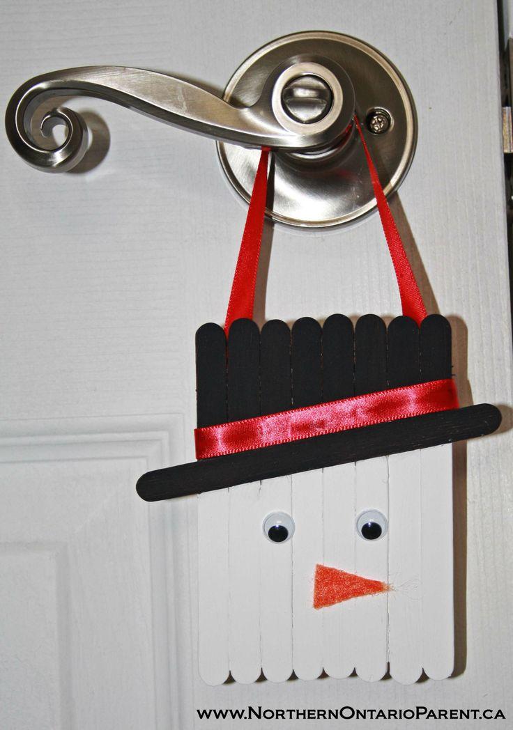 A snowman door knob hanger - here's how to make it: http://www.northernontarioparent.ca/#!craft--popsicle-stick-snowman/c174l