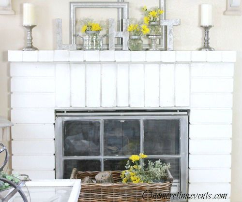 Love the window in the #fireplace opening.  A great spring look! www.homestylingstaging.com