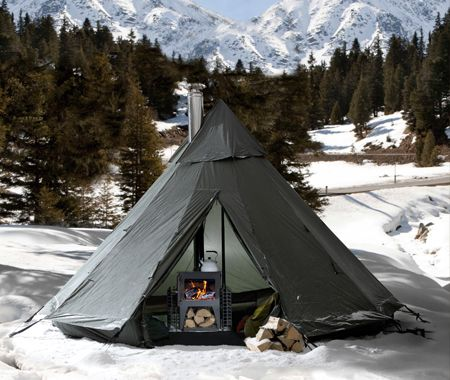 Lavvu camp with stove: Lavvu is the name taken from the temporary dwellings used by the Sami people of northern Scandinavia. It has a design similar to a Native American tipi but is less vertical and more stable in high winds.