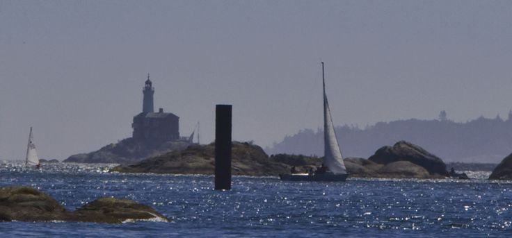 Fisgard Lighthouse - closer shot - with sailboats.  From Portage Park. Photo