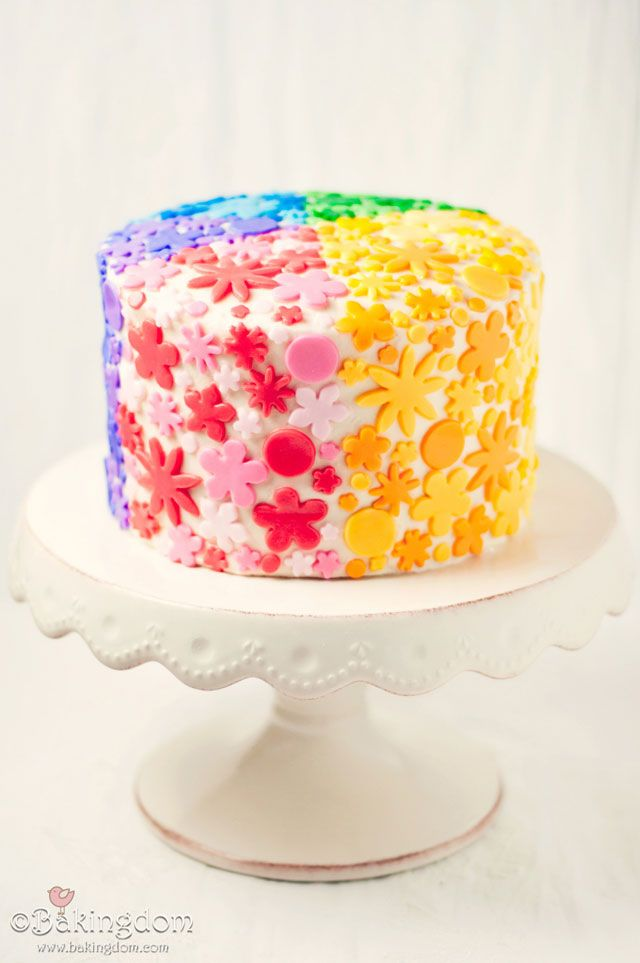 Rainbow Heart Cake - as if the outside of this cake isn't adorable enough the inside is rainbow layers with a heart-shaped middle