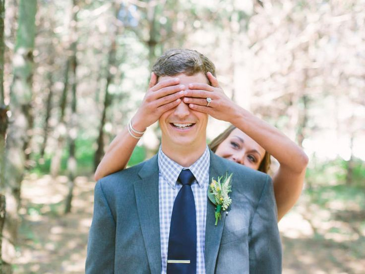 The First Look A playful take on the first look -- with the bride covering her groom's eyes -- is a new classic.