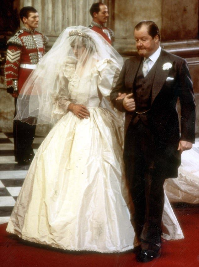 Lady Diana Spencer on the arm of her father, Earl Spencer, on her wedding day, 1981.
