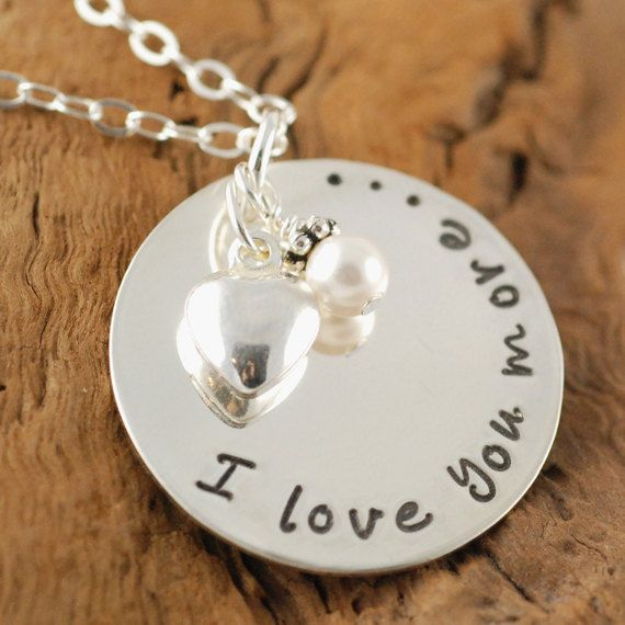 I Love You More... Hand Stamped Necklace features 7/8 sterling silver disc with the phrase I LOVE YOU MORE... This necklace is accented with a swarovski