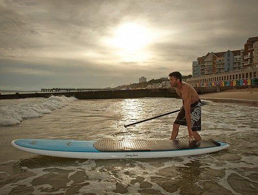 Boscombe Beach, Bouremmouth, England. Stand Up Paddle Boarding at sunset, moody skies, beach life.