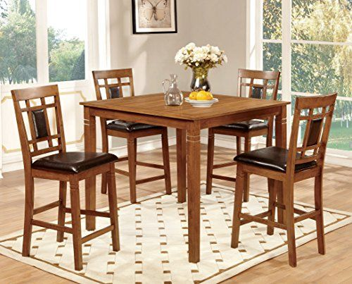 Transitional style inspired dining set Wooden square top dining table and lattice back chairs with padded leatherette seats Finished in light oak, set includes one (1) counter-height table and four (4) counter-height chairs