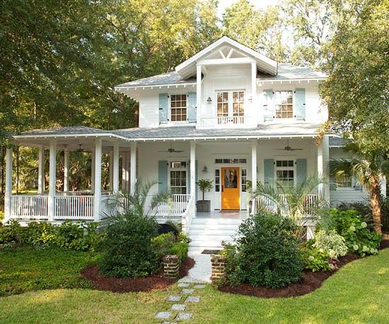 Can you say....AWESOME!  Contemporary Cottage  Bright white paint, blue-gray shutters, and a breezy wraparound front porch give this coastal cottage a vintage beach style. But look a bit closer and you'll notice the home's tangy twist on tradition; the punch delivers the moment you knock on the tangerine door and experience its interior's fresh-squeezed color scheme.