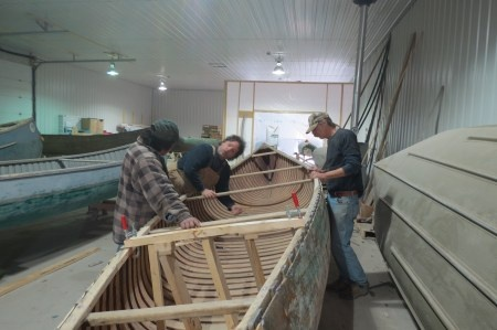Some of the guys up in Fort Severn restoring canoes.