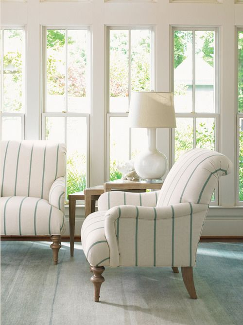 The subtle stripes of this upholstery would be  a pretty alternative to plain white or cream in your dream Hamptons home
