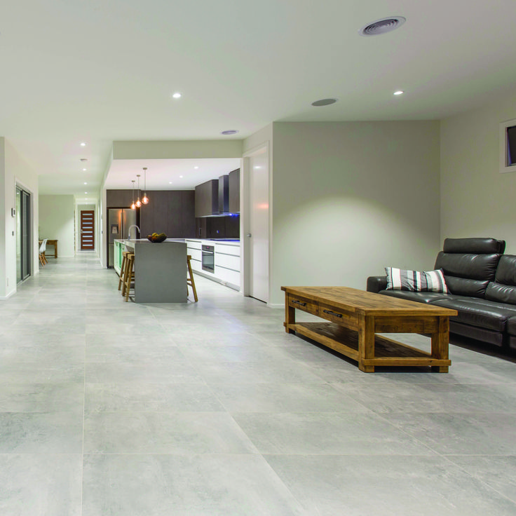 The concrete look is fantastic for living rooms: think large sizes and rectified edges for modern, minimal grout lines.