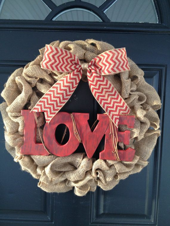 """Handmade, personalized Valentine's Day burlap wreath with the wooden word """"LOVE"""" on Etsy, $55.00"""