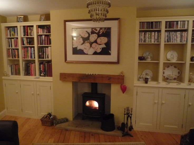 The plan is to create alcoves in the kitchen-diner by building a false chimney breast. We'll then have symmetrical dressers in the alcoves and an electric wood-burner with fire surround.  Image from Dunham Fitted Furniture