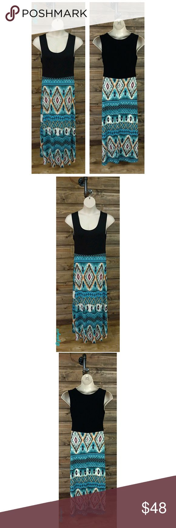 "🚫FINAL PRICE🚫Boho Tribal Plus Size Maxi Dress Boho Chic!  Tribal Print  Plus Size Maxi Dress in Black/Coral/Turquoise/Magenta Multi. Material 92% Polyester 8% Spandex. Length of dress from waistline down 40"". 1X Shown on Standard 1X Plus Form Bust. FOR ADDITIONAL MEASUREMENTS *See Attached Size Chart* TRUE TO SIZE Boutique Dresses Maxi"