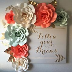 Just got done putting up my paper flowers in my art room I really could stare at them all day lol I don\'t have any heavy duty Velcro strips so I used clear thumb tacks I was just so excited to put them up #followyourdreams #nevergiveup #diy #paperflowers #paperflower #artroom #kellypaper #madewithmichaels #cricut