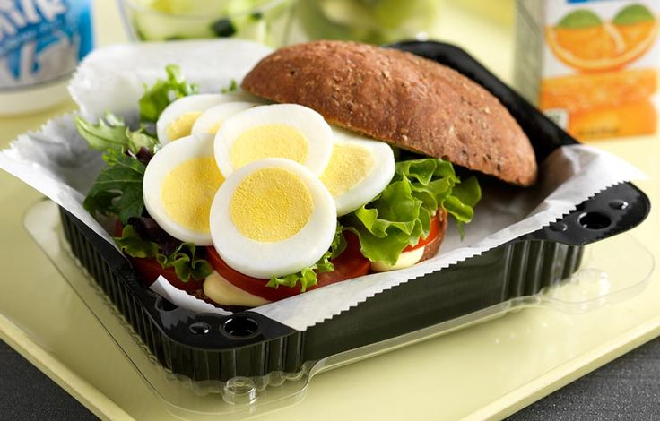 Egg and Bistro Egg Sandwich: Sliced hard-boiled eggs are served on top of mixed baby greens with fresh sliced tomatoes and honey mustard dressing atop a whole-grain Kaiser roll.