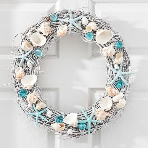Welcome summer beach style to your home with this Live Dried Blue Seashell Wreath featuring genuine seashells mixed with colorful glass baubles and tinted sea stars. $89. Buy here.