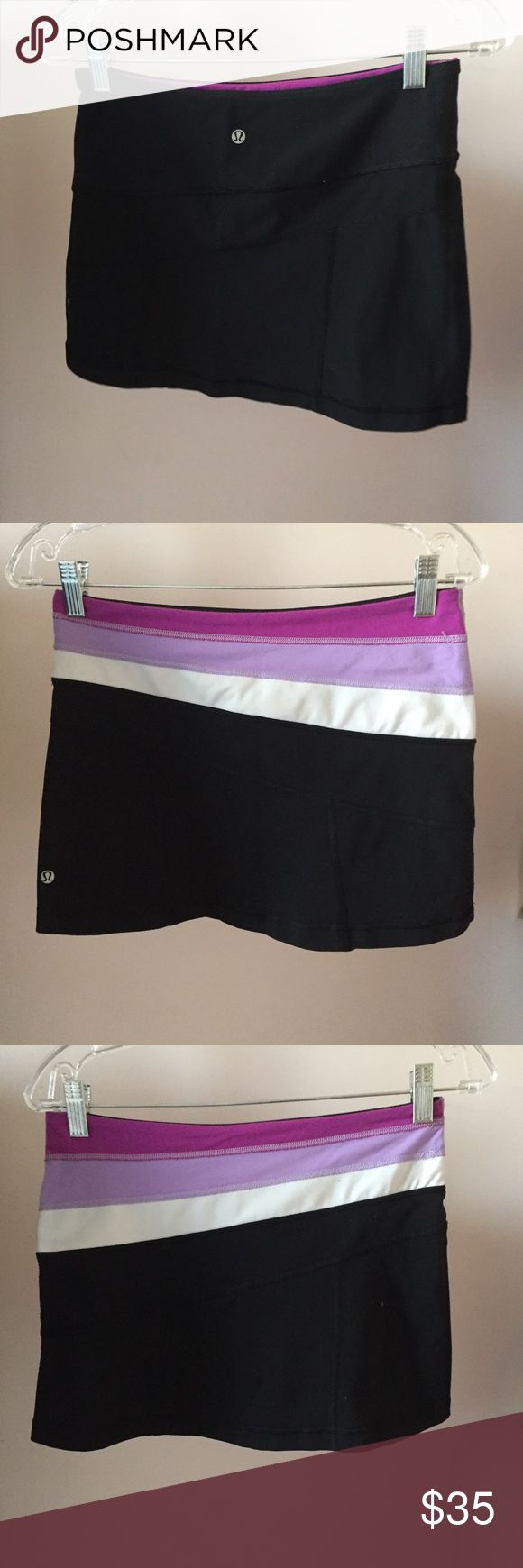 Lululemon Reversible Mini Skirt Brand: Lululemon Condition: Never worn Size: 4 Extra Details: No lining. One side is solid black, the other is black with purple. Please look at pictures for better reference. lululemon athletica Skirts Mini
