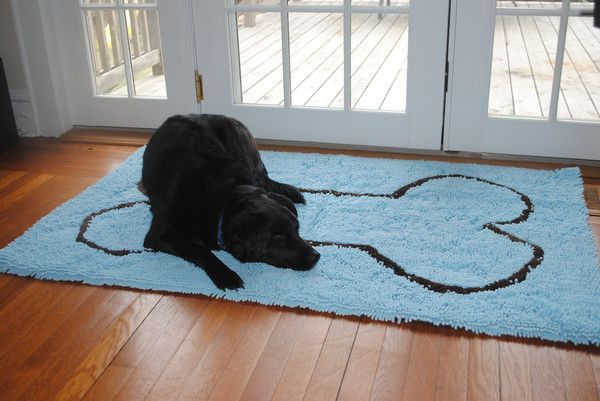 """The microfiber chenille """"noodles"""" are so soft and snuggly, dogs enjoy sleeping on these doormats.  It absorbs more water and dirt than a typical doormat, dries faster, and remains bacteria and odor-free too. Available at OurPamperedHome.com"""