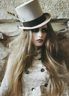 Victorian steampunk female portrait with white top hat