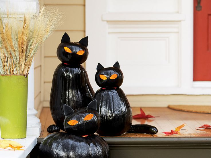 Make Black Cat O'Lanterns | Make your entry glow with fat Halloween cats made from stacked pumpkins (and mini-pumpkin paws)
