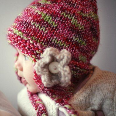 This is an easy to knit feminine earflap hat, set off with a simple flower. Instructions are given for 5 sizes from baby through to adult. Optional ties will secure the hat on a small child, or they can just hang loose for a more casual effect. Instructions are given for both knitting flat on two straight needles and for knitting in the round. Choose whichever method you prefer. As with all my patterns there are clear detailed instructions and plenty of stage by stage photos where needed.