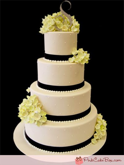 Simple  Elegant Wedding Cake. This without the flowers, an eiffel tower topper and a sparkling C on one of the tiers :) Perfect.