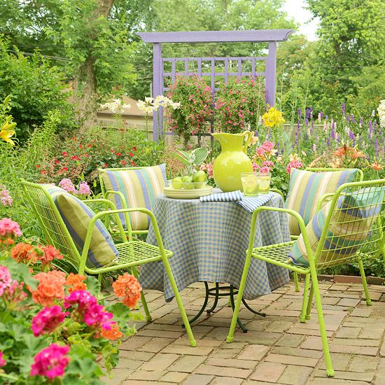 garden: Gardens Ideas, Cottages Style, Cottages Gardens, Outdoor Living, Gardens Patio, Green Chairs, Outdoor Spaces, Bright Colors, Patio Ideas