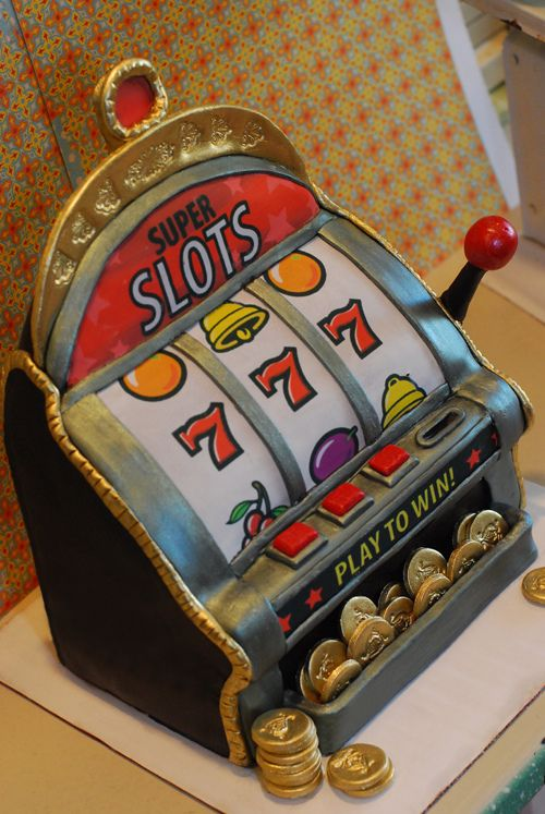 Slot Machine Cake. All edible including coins which are made from sugar. The top jackpot light blinks.  Red Velvet cake with Vanilla Italian Meringue Buttercream