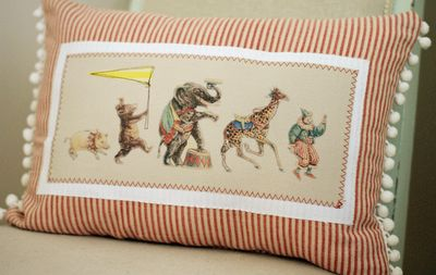Circus pillow. Love it! The red ticking stripe is so totally perfect for this, and the pom poms add just the right amount of whimsy.