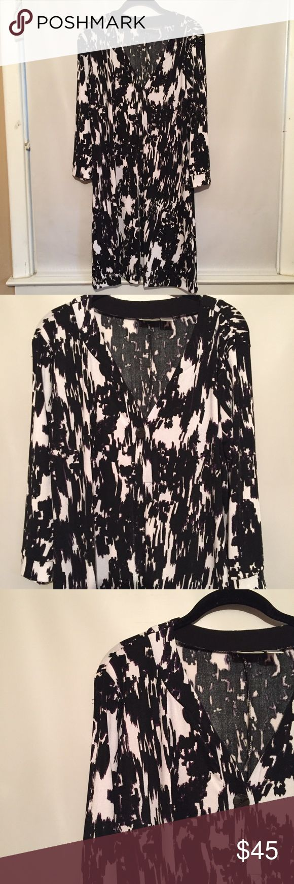 Chico's Long Sleeve Dress Pre-owned condition. Black and white long sleeved dress with purple accent. Size marked 2, but would fit a large or size 12. Chico's Dresses Midi