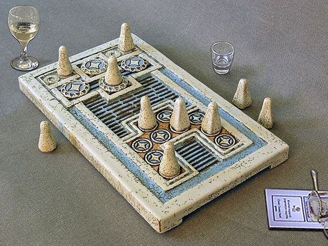 Knossos game is an ancient board game discovered by Evans in the Palace of Knossos and goes back to 1600 BC.