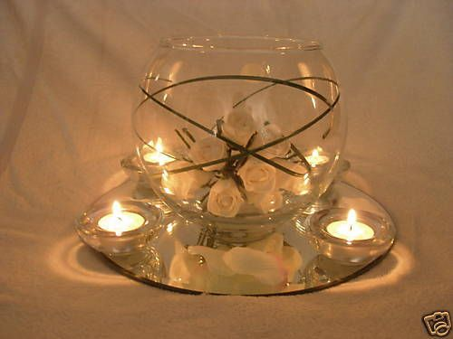 Wedding table centrepiece, goldfish bowls, mirror plate |  - just an idea on layout -- I'd do more flowers in vase