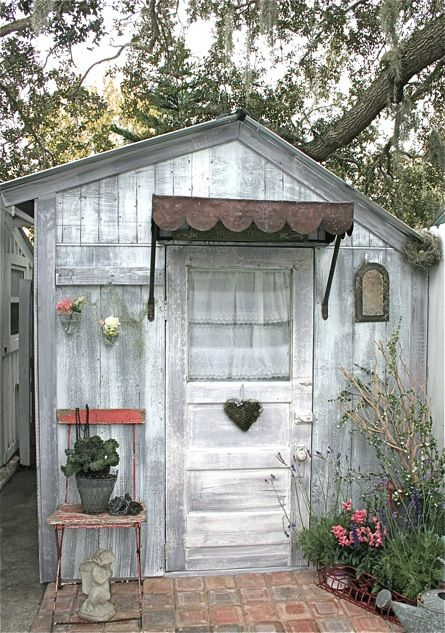 shabby white garden shed~~this would be so cute ina a yard for any girl to play in.  Too bad my grandaughter is 2 old for this.  Maybe who knows~~~ a great granddaughter??  One can HOPE...