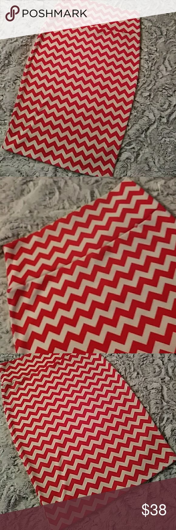 NEW LuLaRoe red and white chevron Cassie skirt Beautiful, chic, lightweight summer and spring skirt... Wear it with a belt, with some leggings on a cool breezy day or on its own! Red and white chevron style design Size XS true to size with lots of stretch and butter soft fabric This skirt is BRAND NEW. The tags were torn off as I planned to keep but never been worn or washed. Too many clothes. LuLaRoe in particular and must downsize! LuLaRoe Skirts