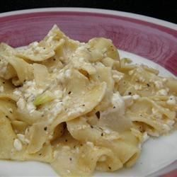 This simple recipe for noodles tossed with sour cream, cottage cheese, and onion cooked in butter can be made as a side dish or a main course.