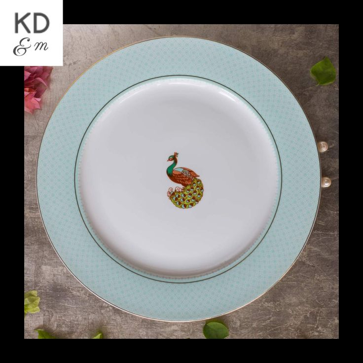 PEACOCK DINNER PLATE This rich & elegant peacock motif Plate is perferct for any formal occasion. Enhance its beauty by clubbing it with golden coloured cutlery. More stuff at www.kitchendining...#KDMORE#dinnerware#crockery#party#partyideas#diningroom
