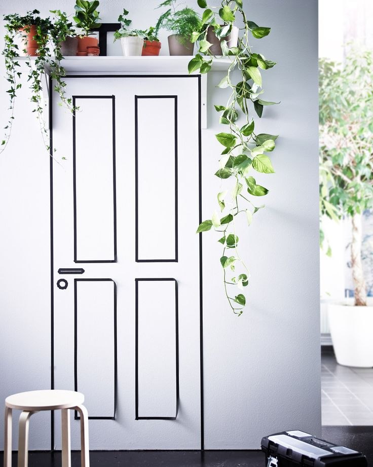 A wall shelf placed over a door is a great place to display trailing plants like ivy.