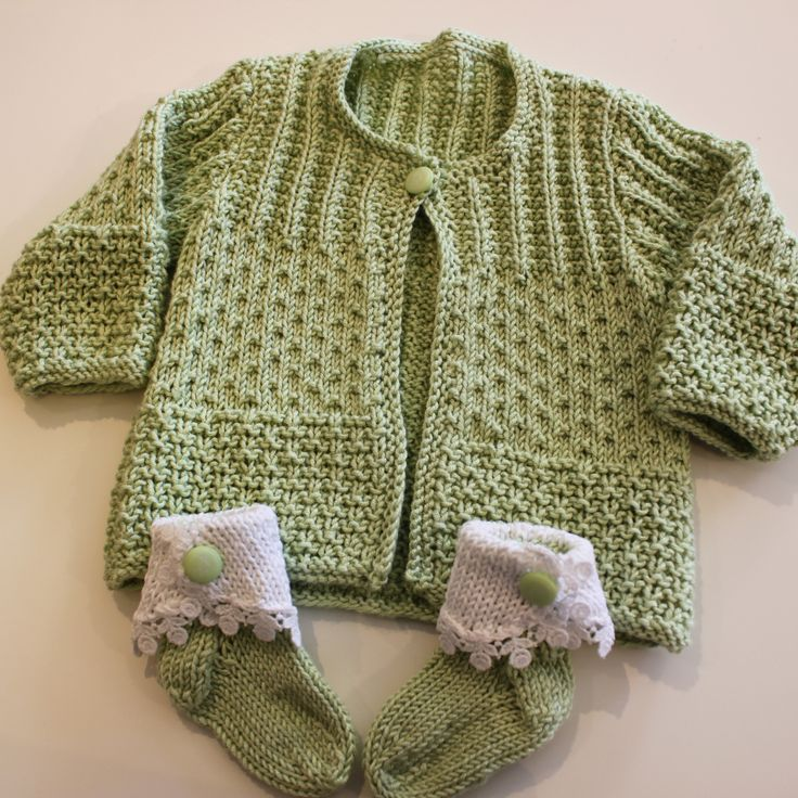 Mont-Tricot Diane knit this lovely baby sweater in Sirdar's Snuggly Bamboo. The socks were made with a bit of leftover yarn and some white cotton added with a touch of lace. What sweet little babe would not look great in this?