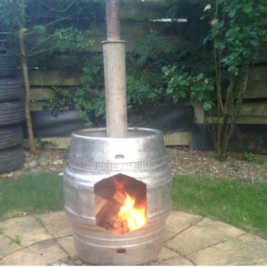 Ghetto Chimnea made from an old beer keg and an exhaust pipe. Upcycled. Recycled. Garden. Fire.