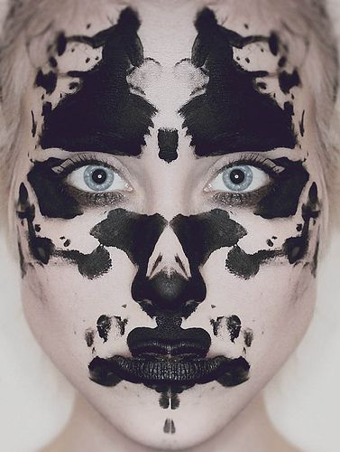 The first thing I see is awesome rorschach makeup. I wonder what it means that the second thing I see are either two samurais dueling and hip bones or two women dancing separately and gingko leaves.