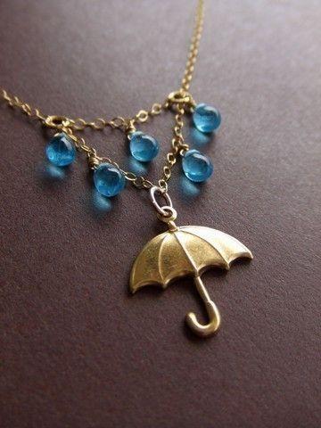 pingente feminino com guarda-chuva