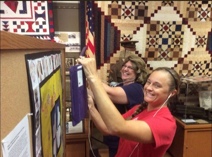 More big smiles as teachers check Aurasma videos in CritterKin Kindness Quilt.